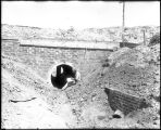 Man Inspecting Culvert