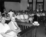 Courtroom scene, Clayton Rand, front row, third from left.