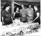Women with vegetable display