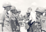 Sonny Montgomery greets soldiers standing in formation