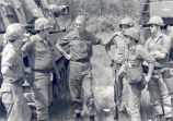 Sonny Montgomery talks with 5 unidentified soldiers