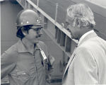Sonny Montgomery speaks to a man in a worker's helmet