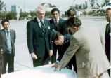 Sonny Montgomery and 4 other men gather around to sign a document
