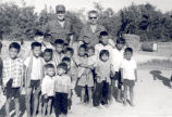 Sonny Montgomery and an unidentified soldier with Vietnamese children