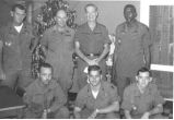 Sonny and six soldiers pose for picture