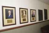 Framed photographs of E. R. Lloyd, J. R. Ricks, and Vance Watson